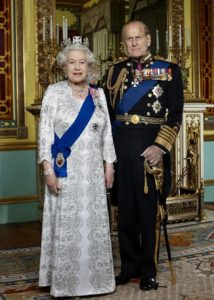 Official Diamond Jubilee portrait of HM The Queen and HRH The Duke of Edinburgh photographed in the Centre Room of Buckingham Palace. in this portrait taken to mark the 60th anniversary of The Queen's Accession. The Queen is wearing a state dress by the designer Angela Kelly and the State Diadem crown. She is wearing Queen Victoria's Collet Necklace, worn for Queen Victoria on the occasion of her own Diamond Jubilee. The sash in the blue Garter Riband. The Duke of Edinburgh is wearing Royal Navy ceremonial day dress (admiral of the Fleet) with Garter Sash. Embargoed until 0001am Monday February 6th 2012.